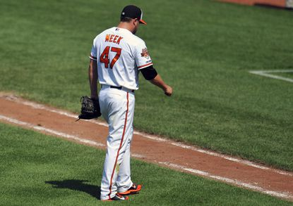 Orioles right-hander Evan Meek walks off the field in the sixth inning against the Tampa Bay Rays at Camden Yards.