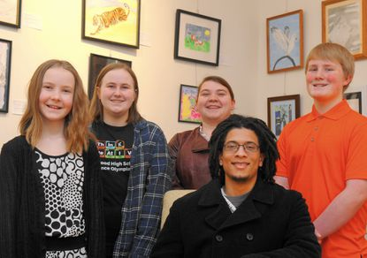 The works of several local students, including from left, Kenzie Aarsen, Katie Aarsen, Jamie Colopietro, Frederique Golden, seated, and Joshua Aarsen, are featured in the exhibit, Unclassified: The Military Kid Art Show in the Hays-Heighe House on the campus of Harford Community College.
