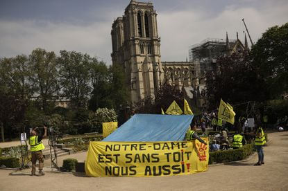 Homeless activists outside Notre Dame demand 'a roof too'