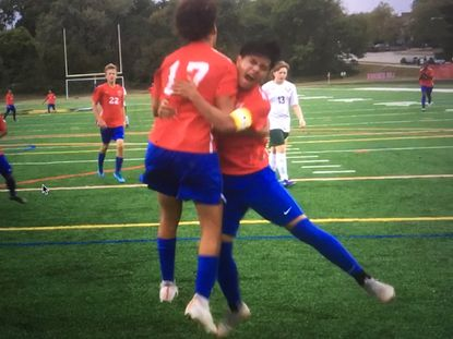 Lansdowne's Van Thang hugs teammate Dom Supak after Thang's cross led to a goal by Supak late in the first half of the Vikings' 1-1 tie with Dundalk.