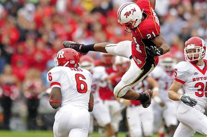 Maryland's Trenton Hughes hits Rutgers' Mohamed Sanu, who had signaled a fair catch on a punt in the first quarter of their game in 2009.