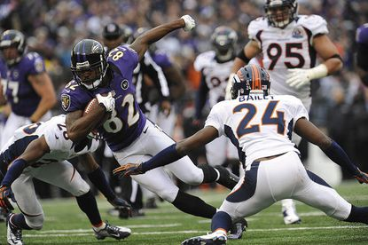 Wide receiver Torrey Smith tries to elude the tackle of Champ Bailey in the Ravens' Dec. 16, 2012 loss to the Denver Broncos in Baltimore. Smith is a strong fantasy start in tonight's game against the Broncos, who will likely be without Bailey.