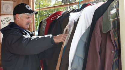 Al Jackson looks through coats at Shepherd's Staff, in Westminster in 2018. The coats were donated through the Call for Coats Program. This year, The Shepherd's Staff is seeking new coats only because of the coronavirus pandemic.