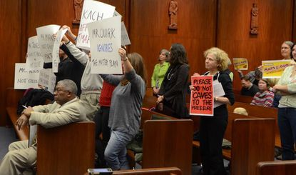 Towson residents show opposition to a gas station proposed for the corner of York Road and Bosley Avenue during a meeting of the Baltimore County Council on Monday.