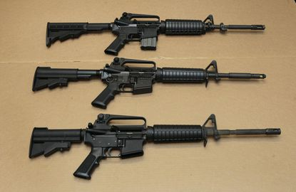 In this file photo, three variations of the AR-15 assault rifle are displayed.