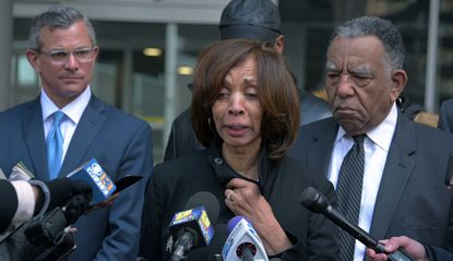 "Catherine Pugh, the former mayor of Baltimore, speaks to reporters in February outside Baltimore's federal courthouse after being given a three-year sentence on charges related to the sales of her self-published ""Healthy Holly"" children's books. She's now returning about $860,000 in campaign contributions."