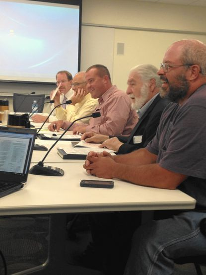 From left to right, mulching task force members Jeff Dannis (Howard County Department of Public Works), Richard Goldman (task force co-chair), Zack Brendel (task force co-chair), Ted Mariani (representing the Concerned Citizens of Western Howard County) and Keith Ohlinger (Howard County Economic Development Authority), present their report to the County Council June 8.