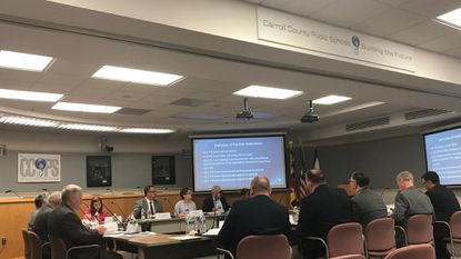 Board members view a breakdown of full-time employee positions reductions during presentation on the budget during a May 15, 2019, work session.