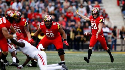 Maryland punter Wade Lees, right, punts the ball in the first half of an NCAA college football game against Rutgers, Saturday, Oct. 13, 2018, in College Park, Md.