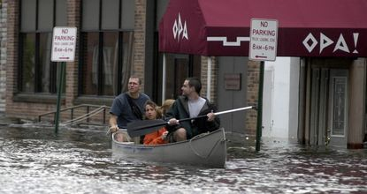 Canoeing through a flooded Fells Point after Tropical Storm Isabel in 2003. Polls show broad support in Maryland for taking action against climate change. (Kim Hairston/Baltimore Sun)