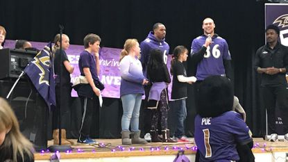 Rodgers Forge Elementary students were treated to a visit by Ravens players Chuck Clark and Nick Boyle (on microphone), plus Ravens cheerleaders and mascot Poe, in recognition of their achievement in the NFL Play 60 program.