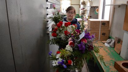Blue Iris Flowers owner Allison Glascock prepares Valentine's Day orders at her temporary storefront in Arbutus last year.