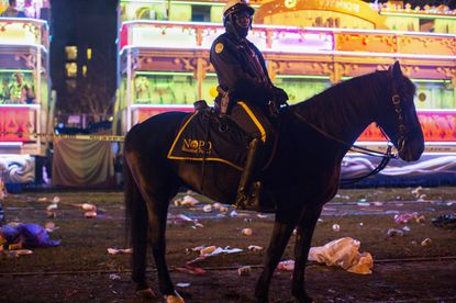 A police officer works the scene where a man was reportedly hit and killed by a float of the Krewe of Endymion parade in the runup to Mardi Gras in New Orleans on Feb. 22, 2020.