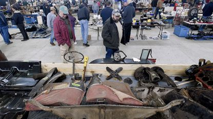Bob and Scott Martin check out a trailer filled with auto parts during the Sugarloaf Mountain Region AACA Indoor/Outdoor Antique and Classic Auto Parts Swap Meet at the Carroll County Agriculture Center. This year's event at the Ag Center is set for March 23 and March 24.