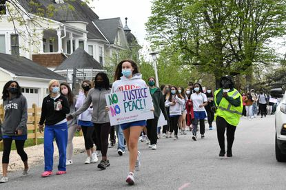 Students from Bryn Mawr, Gilman and Roland Park Country School march in support of a former Bryn Mawr teacher and Black Lives Matter.