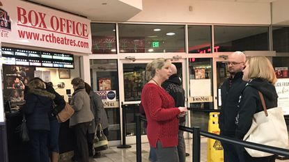 """Susan Beard, who licenses foster homes for the Carroll County Department of Social Services speaks with J.T. and Annie Wojtowicz about foster care and the movie """"Instant Family"""" Nov. 16 R/C Westminster Movies 9, in Westminster TownMall."""