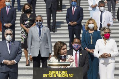 House Speaker Nancy Pelosi of Calif., joined by House Democrats spaced for social distancing, speaks during a news conference on the House East Front Steps on Capitol Hill in Washington on June 25, 2020, ahead of the House vote on the George Floyd Justice in Policing Act of 2020.