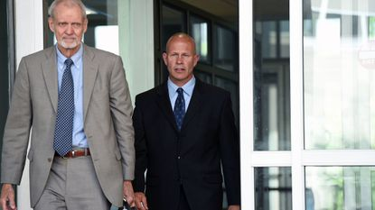 Attorney David Irwin and retired Baltimore City Police Sgt. Keith Gladstone walk outside the Federal Courthouse after Gladstone pleaded guilty earlier this year. He was accused in of planting a toy gun to justify Sgt. Wayne Jenkins of running down a man with his vehicle, an incident at the heart of a lawsuit against the police department.