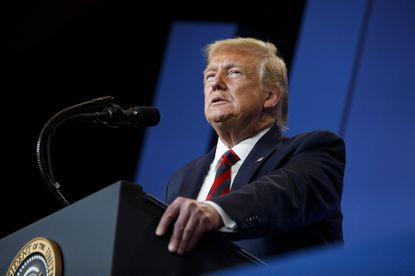 President Donald Trump pauses as he speaks at the 2019 House Republican Conference Member Retreat Dinner in Baltimore.