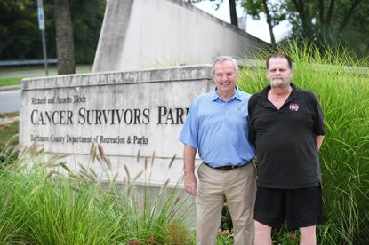 Jim Higbee of Towson, left, a volunteer driver with the American Cancer Society's Road to Recovery program, stands with David Fitzgibbons of Cockeysville, who he drove to treatments over 30 times, in the Richard and Annette Bloch Cancer Survivors Park in Towson.