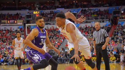 Maryland's Justin Jackson drives past Northwestern's Sanjay Lumpkin during the 2017 Big Ten basketball tournament quarterfinals.