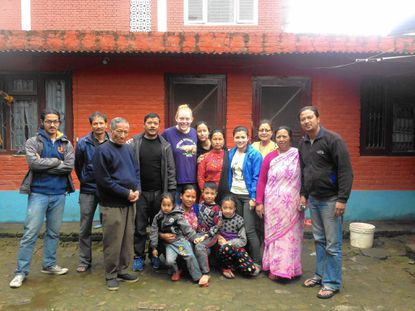 McDaniel College student Leigh Brownell, fifth from left in back, is shown with her host family in Nepal during a study abroad trip. She survived the recent earthquake near Kathmandu where thousands have died and been injured.