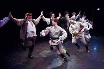"""The Russians join the dance celebrating the engagement of Lazar Wolf and Tzeitel in Toby's Dinner Theatre of Columbia production of """"Fiddler on the Roof."""""""