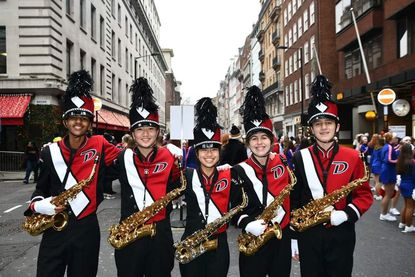From left, Miles Sheppy, Jonathan Zhang, Kristine Xie, Sarah Nelson and Jason Longley, shown in London, are saxophonists in the Dulaney High School Lion's Roar Marching Band, which appeared in the English capital's New Year's Day parade for a third time.
