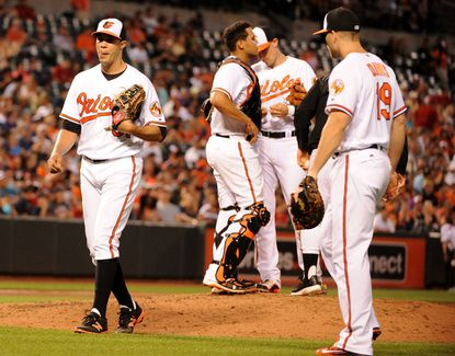 Ubaldo Jimenez walks off the field and is replaced by pitcher Mychal Givens. The Baltimore Orioles take on the Boston Red Sox Thursday, June 2, 2016. Caitlin Faw/Baltimore Sun staff