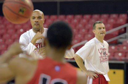 Terps assistant Dalonte Hill (left) and head coach Mark Turgeon oversee a practice.