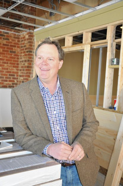 Patrick Russell, seen here in early stages of renovations being done to the former Chop's Restaurant space in the Manor Shopping Center, plans to open Kooper's Jacksonville tavern in the space in June.