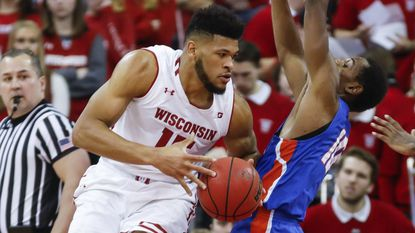 Wisconsin's Charlie Thomas maneuvers against Adam Saeed Dec. 13 in Madison. Thomas is averaging just 4.3 minutes but is coming off a big game against Nebraska.
