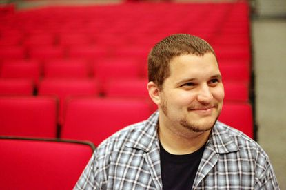 """Stage manager Colin Parker smiles while watching a rehearsal of """"Shrek the Musical."""""""