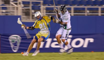 Kevin Crowley (21) of the Florida Launch looks to pass during a game against the Chesapeake Bayhawks at FAU Stadium on June 28. The Bayhawks won, 18-11, but they are now back in last place.