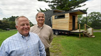 The Mid-Atlantic Tiny House Expo organizers Frank Hazzard (left) and Kirk Johnson stand by a home that will be at the event.