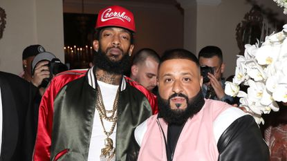 Rapper Nipsey Hussle, left, and DJ Khaled attend a 2017 party in Beverly Hills.