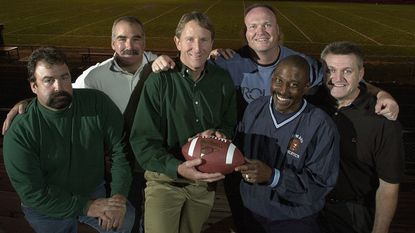 Howard High alumni pose for a photo in 2001. Left to right: Chuck Lewis (1973-1974), Kevin Wynn (1974-1975), offensive coach Chuck Bragg (1974), Scott Swope (1973-1974), Albert Robinson (1973-1974) and Bob Bonneville (1971-1972).