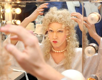 "Tim Elliott puts on makeup for his role at the Fells Point Corner Theatre's 2011 production of ""Compleat Female Stage Beauty."" The theater is currently closed because of the COVID-19 pandemic but its president looks forward to brighter days ahead. File. (Algerina Perna/Baltimore Sun)."