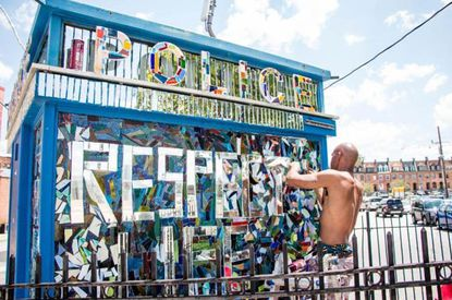 """Artist Loring Cornish, known for his distinctiveglass mosaics, transforms a former police box in Station North into a structure titled""""Change for the Better."""""""