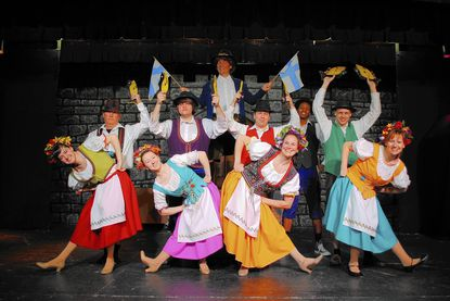 """Early in Monty Python's """"Spamalot,"""" Finns perform the """"Fisch Schlapping Song."""" To find out why, you'll have to see the show. Pictured, from left, are the Finns, Samantha Murray, Mark Gallihue, Suzanne Hasselbusch, Emil Brandau, Robert Bupp, Stanton Zacker, Carissa Lagano, Rondez Green, Joe Weinhoffer and Judy Scott."""