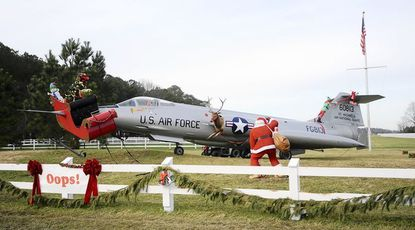 Tom and Alice Blair's Christmas display in St. Michaels features Santa's sleigh caught on the nose of an F-104 jet.
