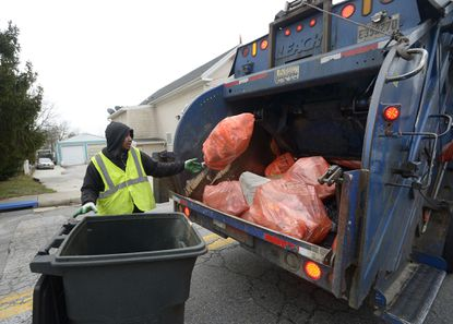 José Urias of Ecology Services Refuse and Recycling collects garbage in January.