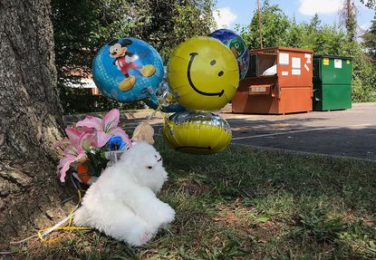 A makeshift memorial outside the dumpster where 4-year-old Malachi Lawson's body was found.
