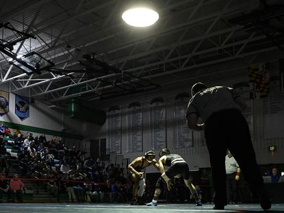 Issac Barber of South River (left), seen wrestling during the Anne Arundel County finals last season, helped the Seahawks beat Damascus on Dec. 14.