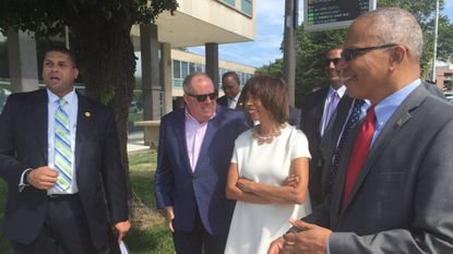 Maryland Gov. Larry Hogan and Baltimore Mayor Catherine Pugh tour the State Center site and discuss redevelopment possibilities. Long-planned redevelopment at the site has stalled amid a court fight between the state and the previously chosen developer, Ekistics LLC.