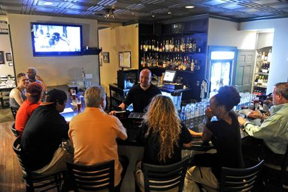 Bar manager Jeff Levy holds court at Mount Vernon's Tavern on the Hill.