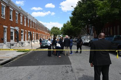 Police investigate a shooting scene with multiple victims in Baltimore's Penrose neighborhood Wednesday afternoon.