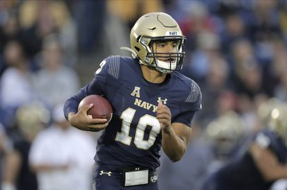 Navy quarterback Malcolm Perry scrambles against Tulane during the second half of an NCAA college football game, Saturday, Oct. 26, 2019, in Annapolis. Navy won 41-38. (AP Photo/Julio Cortez)