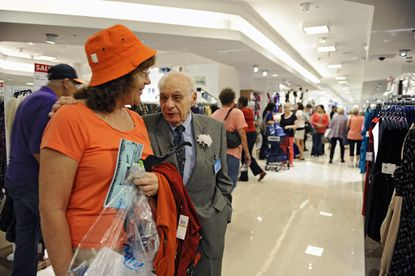 Albert Boscov, center, chairman and CEO of Boscov's, talks with customer Mary Dorsch, left, of White Marsh, during the department store's soft opening. Boscov's returns to Baltimore at its former site in White Marsh Mall with a soft opening preview day of shopping and giveaways. Grand opening will be on Sunday October 7.