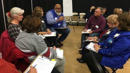 During Harford Community College's Future Summit, a breakout group discusses the most compelling or surprising things they had learned from the presentations and which they believed would have the greatest impact on the future of HCC.